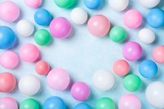Colorful balloons on blue table top view. Birthday or party background. Flat lay style stock images