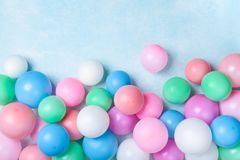 Colorful balloons on blue table top view. Festive or party background. Flat lay style. Birthday greeting card. Colorful balloons on blue table top view. Festive royalty free stock images
