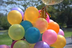 Colorful balloons with celebration and various party confetti.  Royalty Free Stock Photos