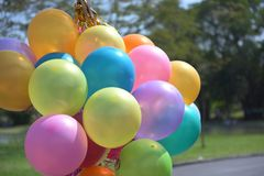 Colorful balloons with celebration and various party confetti.  Stock Photography