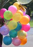 Colorful balloons with celebration and various party confetti.  Stock Image