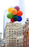 Colorful balloons in the city. Colorful bunch of balloons bob in the windy city Stock Photos