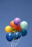 Colorful balloons in a clear blue sky Stock Photography