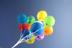 Colorful balloons in a clear blue sky royalty free stock photos
