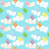 Colorful balloons and clouds on blue sky. Seamless pattern. Vector illustration in flat style Stock Photos
