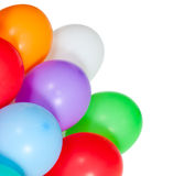 Colorful balloons in the corner on white Stock Photos
