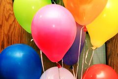 Colorful Balloons and a door. Colorful latex balloons tied with ribbons `include, pink, yellow, blue and green Stock Photos
