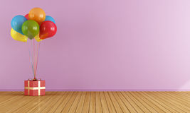 Colorful balloons in a empty pink room Stock Image