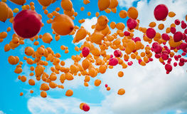 Colorful balloons in flight Stock Photo