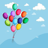 Colorful balloons floating in the sky Stock Image