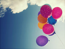 Colorful balloons flying on the blue sky Royalty Free Stock Images