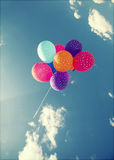 Colorful balloons flying on the blue sky Stock Image