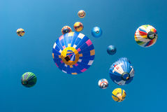 Colorful balloons flying. Colored balloons on a background of blue sky Royalty Free Stock Photo
