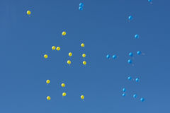 Colorful balloons flying high in the sky. Ukraine Royalty Free Stock Image