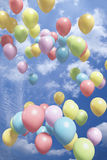 Colorful Balloons Flying In The Air Stock Photography
