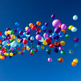 Colorful Balloons flying in the sky party Stock Image