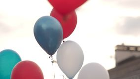 Colorful balloons are flying in the sky. People release balloons.