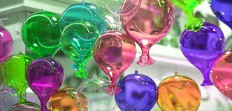 Colorful balloons flying towards freedom. Fantasy of colors hanging from the sky stock photo
