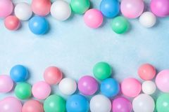 Colorful balloons frame on blue table top view. Festive or party background. Flat lay style. Birthday greeting card. Colorful balloons frame on blue table top royalty free stock photo