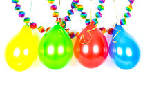 Colorful balloons and garlands. Party decoration. On white Stock Photos
