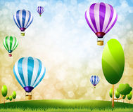 Colorful balloons. On Green meadow Royalty Free Stock Image