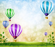 Colorful balloons. On Green meadow Royalty Free Stock Photos