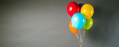 Colorful balloons on the grey background close up. stock images
