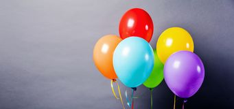 Colorful balloons on the grey background close up. stock photos