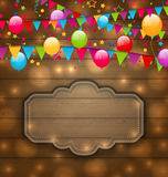 Colorful balloons, hanging flags on wooden texture, place for yo Stock Images