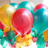 Colorful balloons with happy celebration party Stock Images