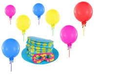Colorful balloons and hat with mask Stock Image