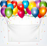 Colorful balloons holding up a cloth white banner. Stock Photo