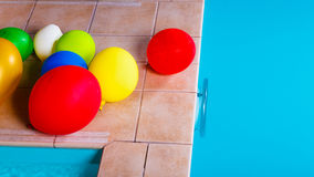Colorful balloons at hotel swimming pool Stock Photos