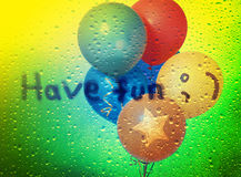 Colorful balloons and inscription Have fun! Stock Photography