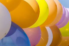 Colorful balloons. Lots of colorful balloons arranged in a line close up Royalty Free Stock Image