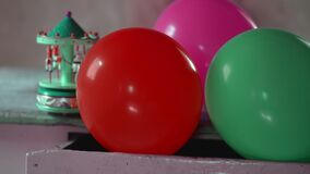 Colorful balloons in an old furniture