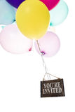 Colorful balloons, old sign, you're invited Stock Photos
