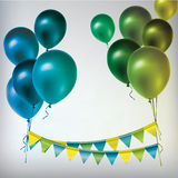 Colorful balloons and paper garland. Stock Images