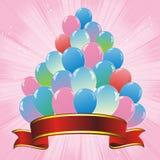 Colorful balloons pyramid and red ribbon Royalty Free Stock Image