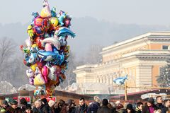 Colorful balloons for sale, stalls with fast food and many people during the town fair in Pernik, Bulgaria - Jan 27, 2018 Royalty Free Stock Photos