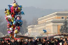 Colorful balloons for sale, stalls with fast food and many people during the town fair in Pernik, Bulgaria - Jan 27, 2018 Royalty Free Stock Images