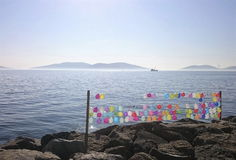 Colorful balloons with stones and sea on the background. Colorful balloons & stones & sea on the background Stock Image