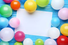 Balloons with sheet of blank paper