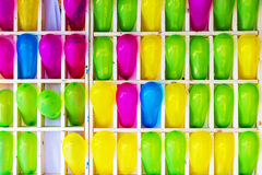 Colorful balloons on shelves of wooden box. Royalty Free Stock Photography