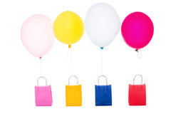 Colorful balloons with shopping bags, isolated on white Stock Photo