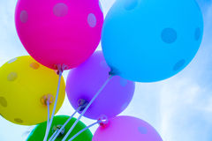 Colorful balloons on the sky background. Festive air balloons from below. Royalty Free Stock Images