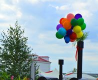 Colorful balloons on sky background in summer city Park Royalty Free Stock Photo