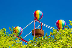 Colorful balloons on small basket ferris wheel Royalty Free Stock Image