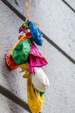Colorful balloons in the street. Colorful popped balloons in the street Stock Photos