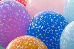 Colorful balloons on strings Stock Images